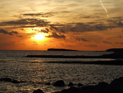 The sun setting over Galway Bay Ireland
